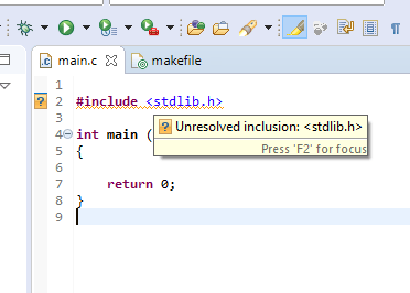 "Screenshot of the code editor with a dummy main function to be used for demonstration. A popup warning is shown with informs the user of the unresolved inclusion of ""stdlib.h""."
